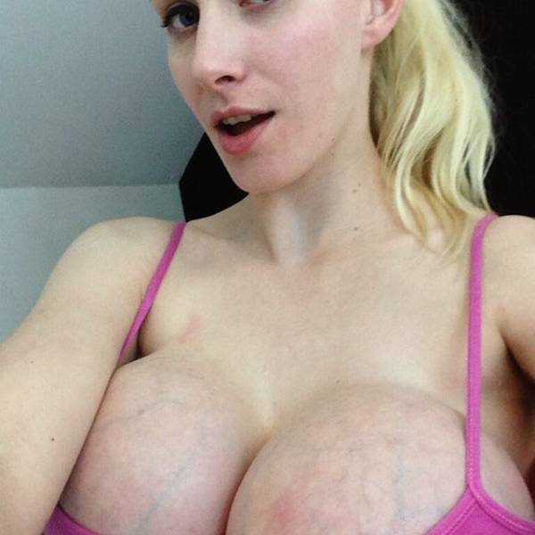She Just Can't Have Enough Of Her Breasts
