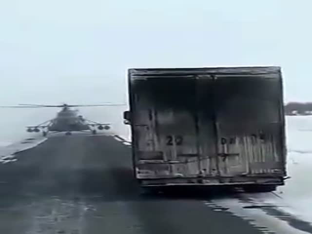 Helicopter Pilot Casually Asks A Truck Driver For Directions