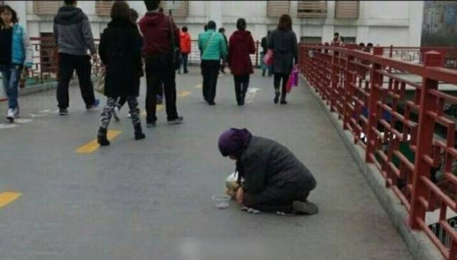This Chinese Beggar Looks Like She Eats The Money She