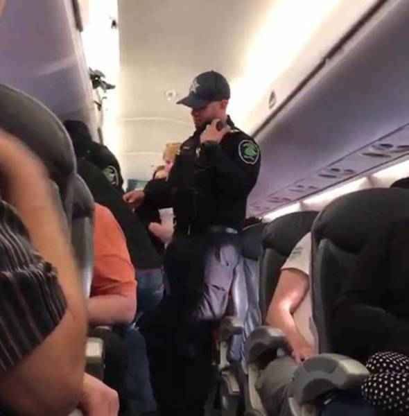 Is It Normal To Beat Up Your Passengers If They Don't Want To Leave The Flight They Paid For?