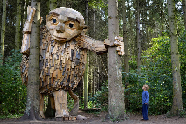 This Artist Creates Phenomenal Giant Sculptures From Recycled Wood In Completely Unexpected Places