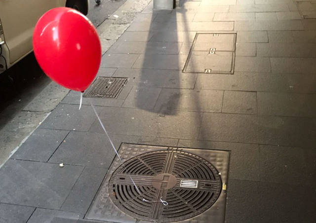 Sydney Is Full Of Red Balloons Tied To Sewer Gates. And Here's Why