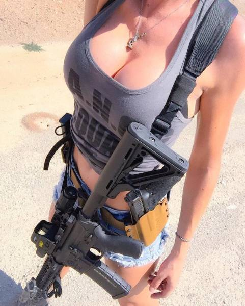 Awesome Girls Holding Big Guns – What Could Be Better?