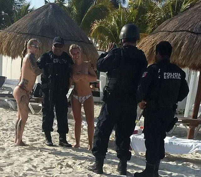 Cancun Cops Got Punished For… Posing With Topless Girls