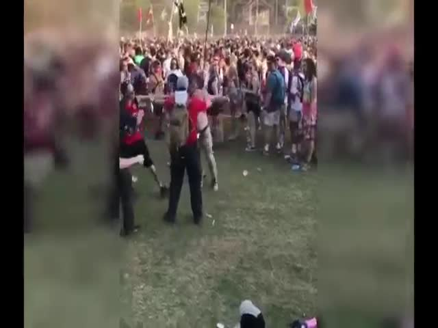 A Way Too High Dude Gets Taken Down On A Festival