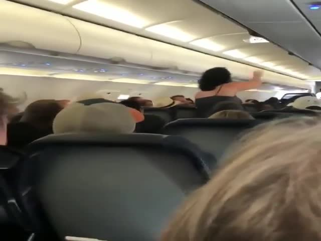 Lady Goes Crazy On A Plane Before Take Off