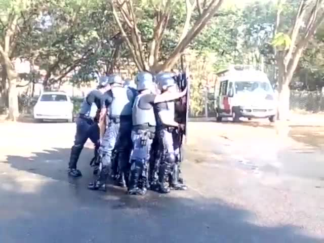 Clash Of Riot Police And Fire Department