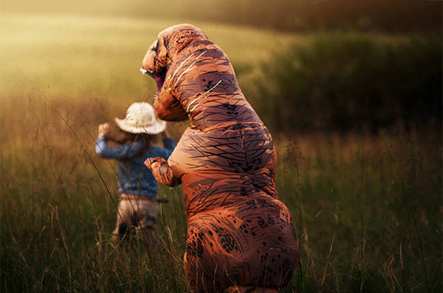 Your Son Doesn't Like Being Photographed? Give Him A T-Rex Suit!