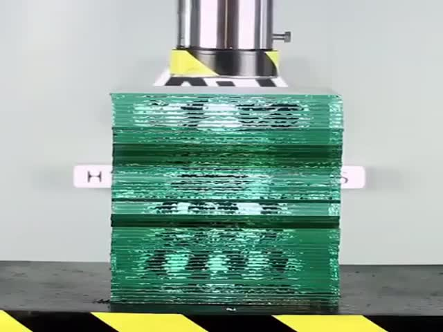 Sheets Of Glass Try To Stop A Hydraulic Press