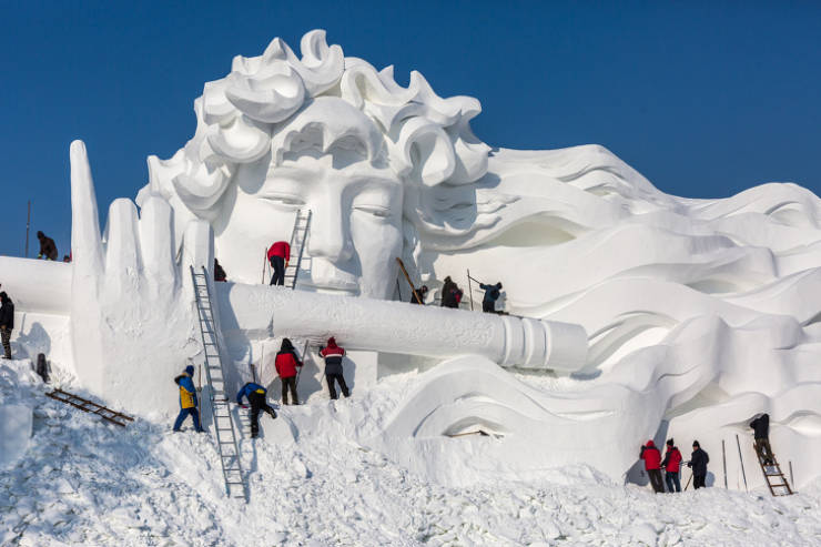 Beautiful Snow & Ice Sculptures That Unfortunately Can't Be Frozen In Time