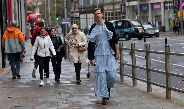 Correspondent Walks Through London Streets Wearing A Long Dress
