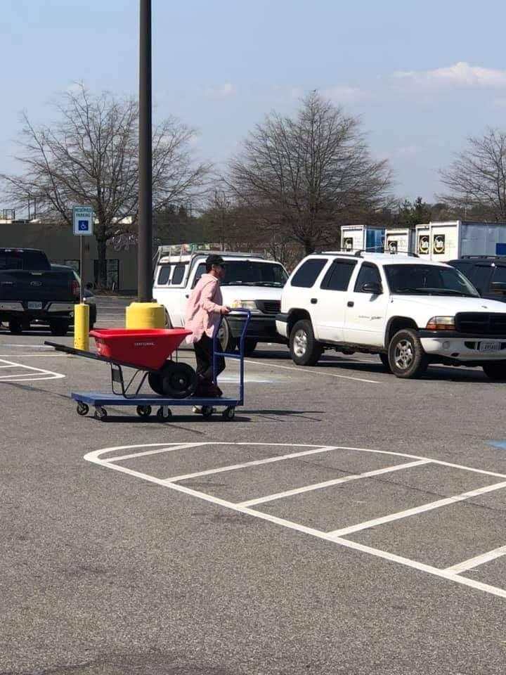 A man pulls a cart on a trolley.