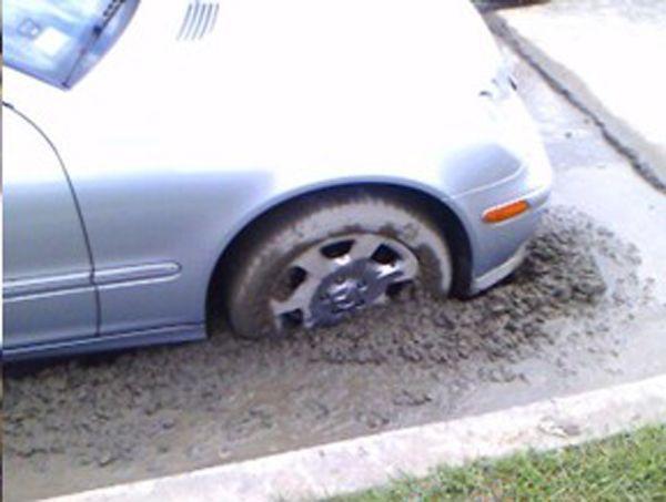 Car in fresh cement (4 photos)