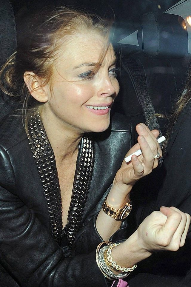 Lindsay Lohan exiting Cuckoo club in London. It seems she had lot of fun (10 pics)