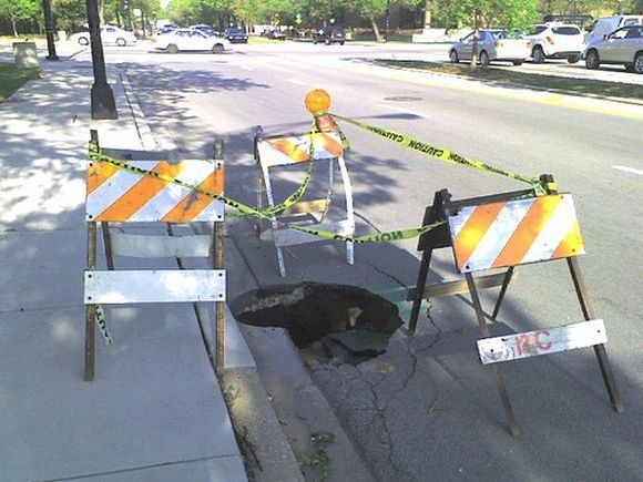 Compilation of dangerous holes in roads (18 pics)