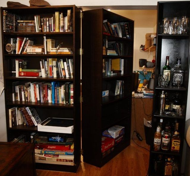 Concealed room behind a bookcase door (7 pics)