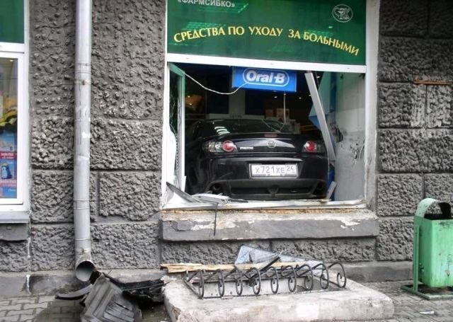Mazda against the pharmacy (4 pics)