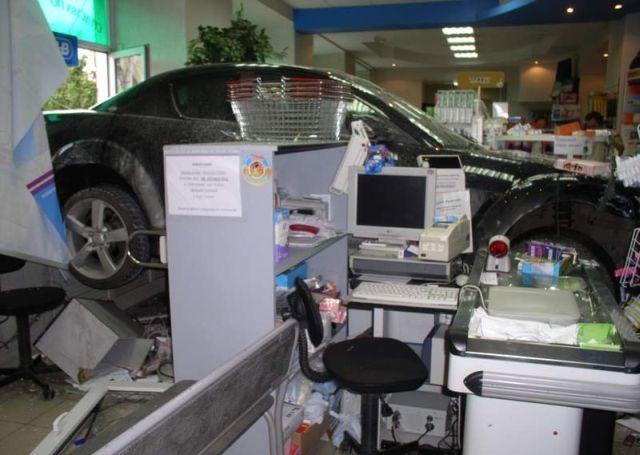 Mazda against the pharmacy (4 pics)
