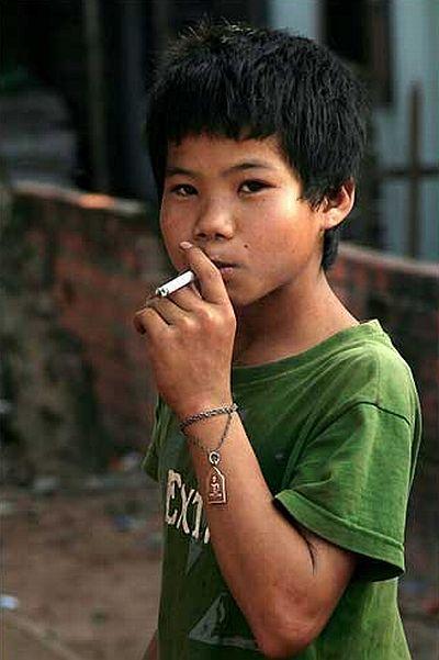 Kids smoking cigarettes right!