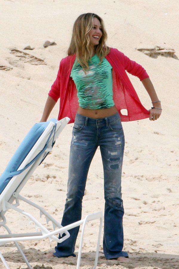 Amusing Doutzen Kroes during a photo shoot on the beach (15 pics)