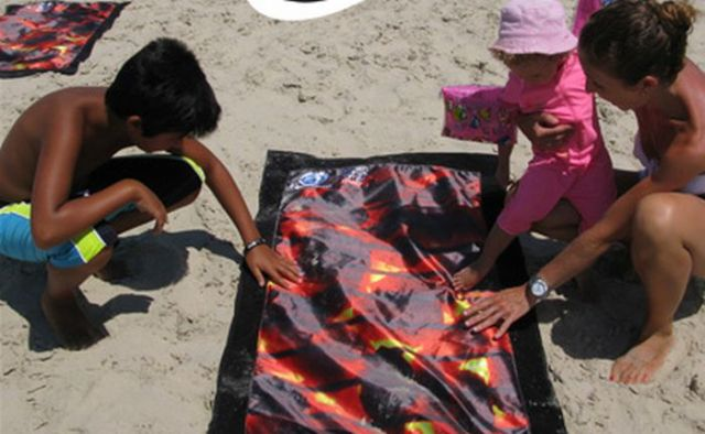 Beach towels that warns people about damage of sun exposure (6 pics)