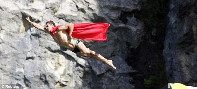 Cliff diver in a Supeman cape (6 pics)