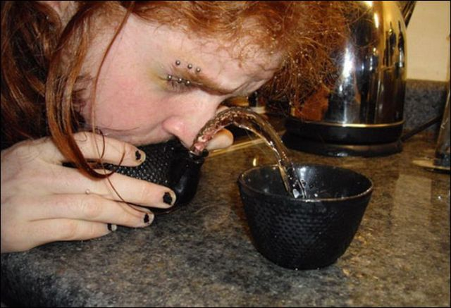 Unusual contest for blowing water out from a teapot (18 pics)