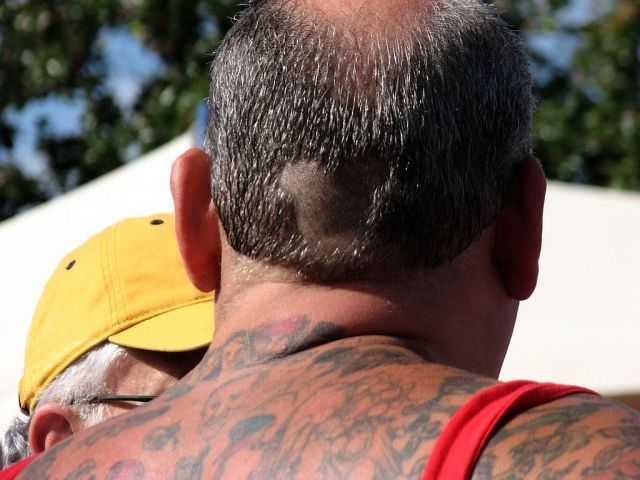 Man with Disneyland cartoons tattoos (15 pics)