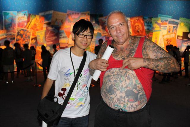 Man with Disneyland cartoons tattoos (15 pics)