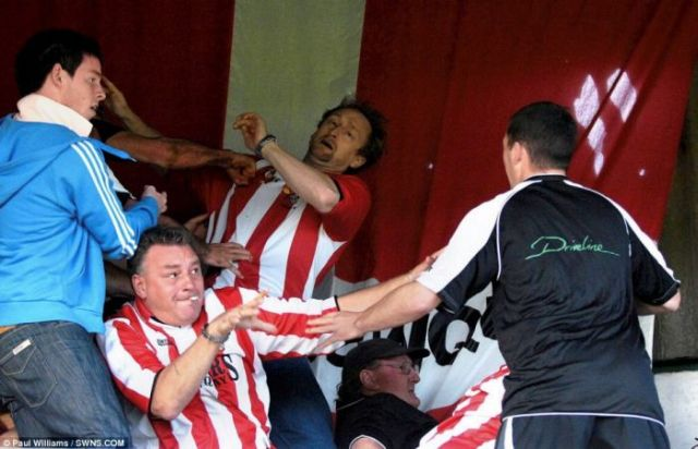Soccer Player Climbs into the Stands to Attack a Fan of the Opposite Team (11 pics)