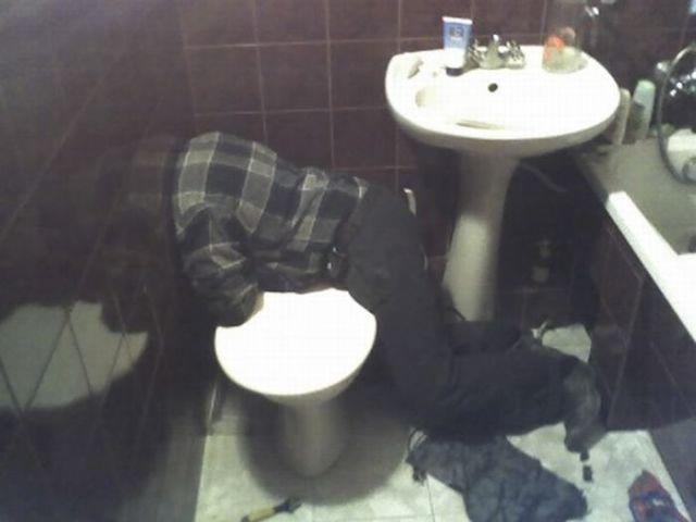 Headless Plumber in the Toilet (2 pics)