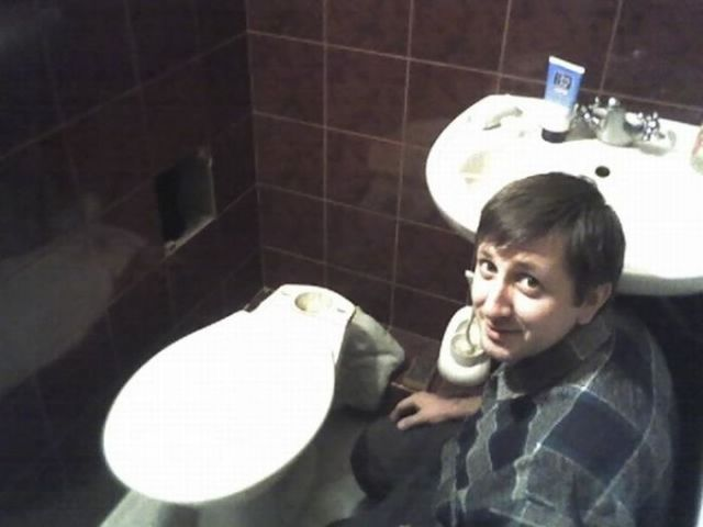 Headless Plumber in the Toilet (2 pics)