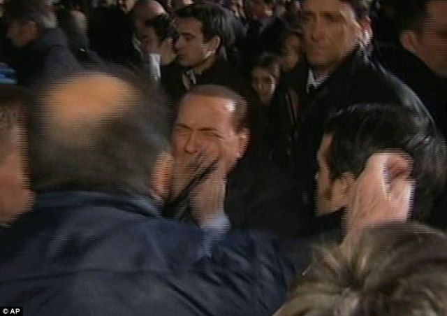 Berlusconi Gets a Broken Nose and Loses Two Teeth during the Assault (7 pics+1 video)