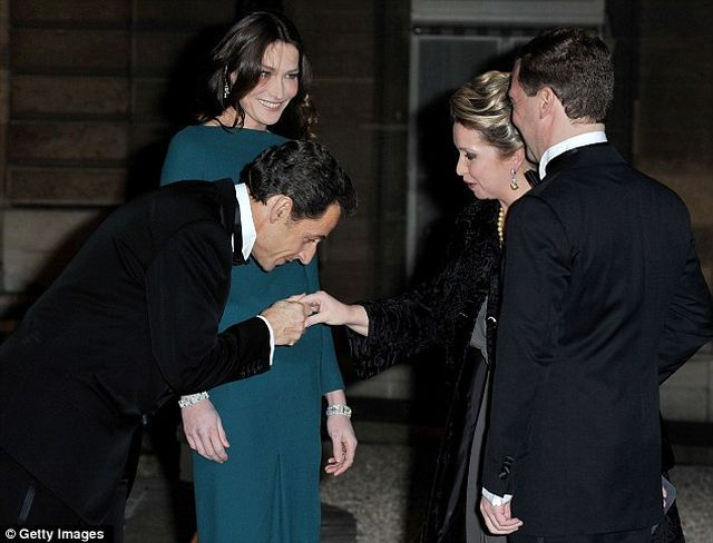 French President's Wife Met Russian President in an Almost 'See Through Dress' (5 pics)