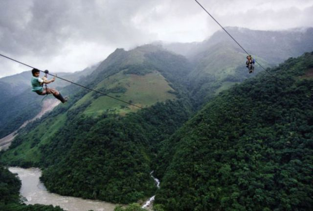 Riding a Zipline to School (8 pics)