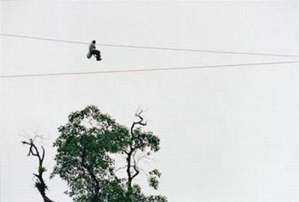 Riding a Zipline to School (8 pics)