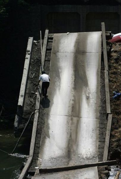 The Car Was Too Heavy for the Bridge (7 pics)