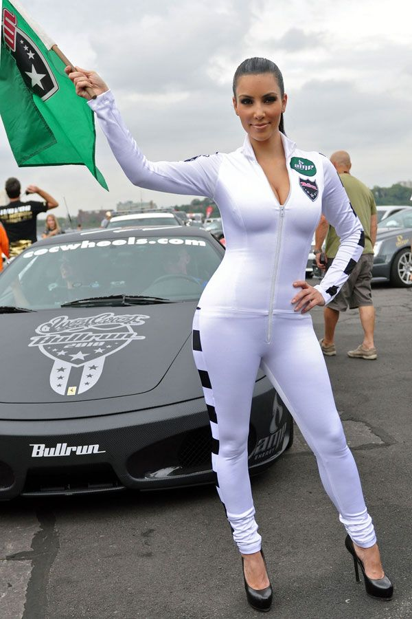 Kim Kardashian in a Tight Racing Suit (8 pics)