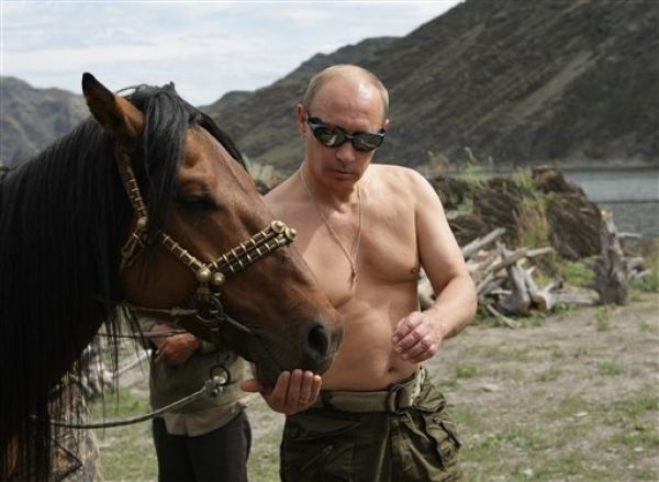Cute Photos of Action Man Vladimir Putin with Animals