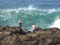 Couple Washed off Rocks by Big Wave