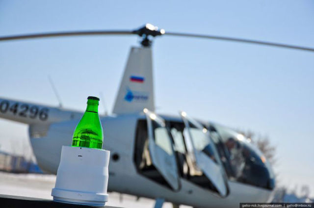How to Open a Bottle with a Helicopter
