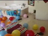 Dog Celebrates Birthday with Room Full of Balloons