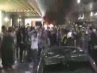 Women Trying to Defend Their Car from Vancouver Rioters