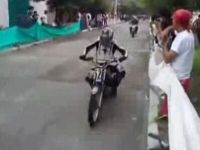 Motorcycle Crashes on Woman during Race