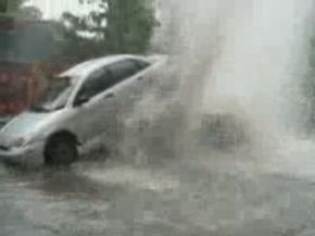 Sewer Geyser Damages Car. Very Impressive