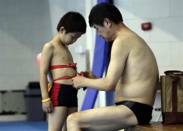Chinese Kids Learning How to Swim