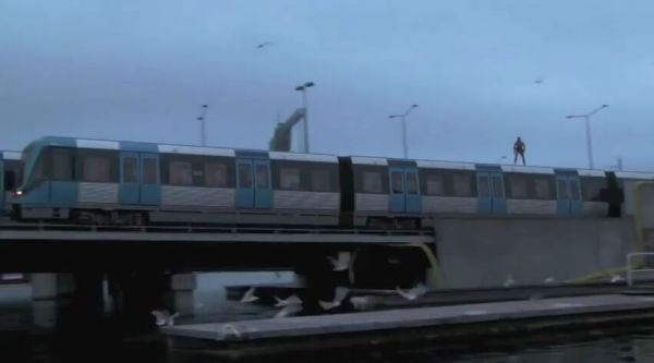 Crazy Train Surfer Jumps from Moving Train [VIDEO]
