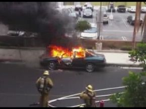Burning Car Explodes in Fireman's Face