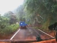 Truck Knocked Off by Land Slide