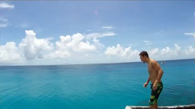 Guy Makes Crazy Dive Off Hotel Roof [VIDEO]